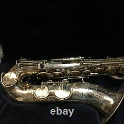 King Zephyr tenor sax, brass, new felts, pads, and corks, good playing condition